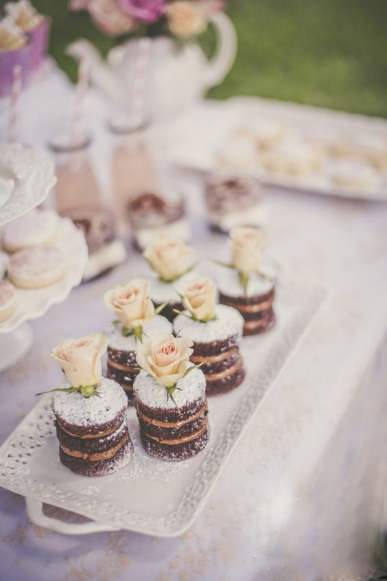chocolate naked individual wedding cakes with sugar powder and blush roses are amazing for a romantic wedding