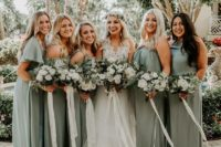 mismatching sage green bridesmaid dresses and a white lace wedding dress with a layered skirt