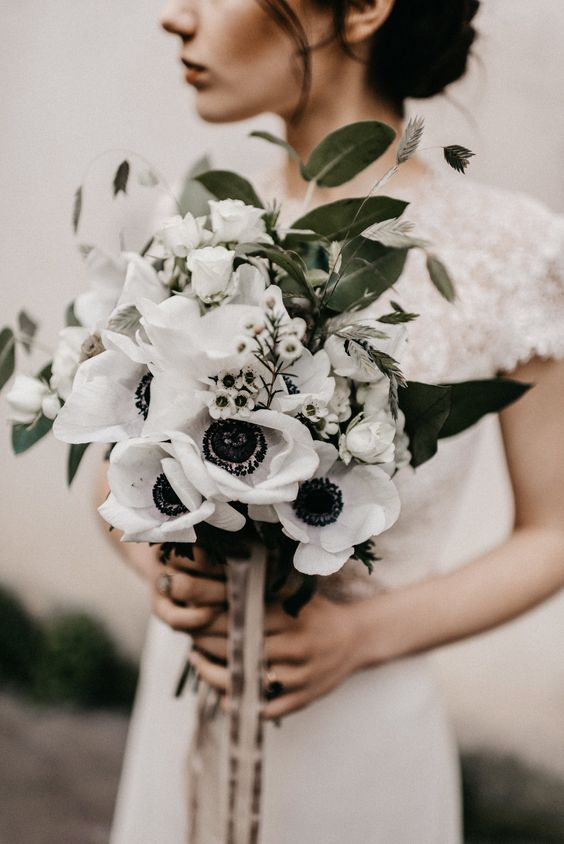 white blooms, greenery and neutral ribbons make this bouquet super cool and chic