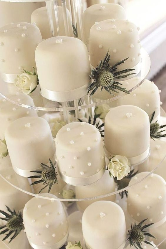 white mini cakes with edible pearls and beads are amazing for a refined neutral wedding