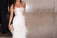 Priyanka Chopra wearing a gorgeous strapless dress with a draped top and a feather maxi skirt, blush shoes and a clutch and a diamond necklace