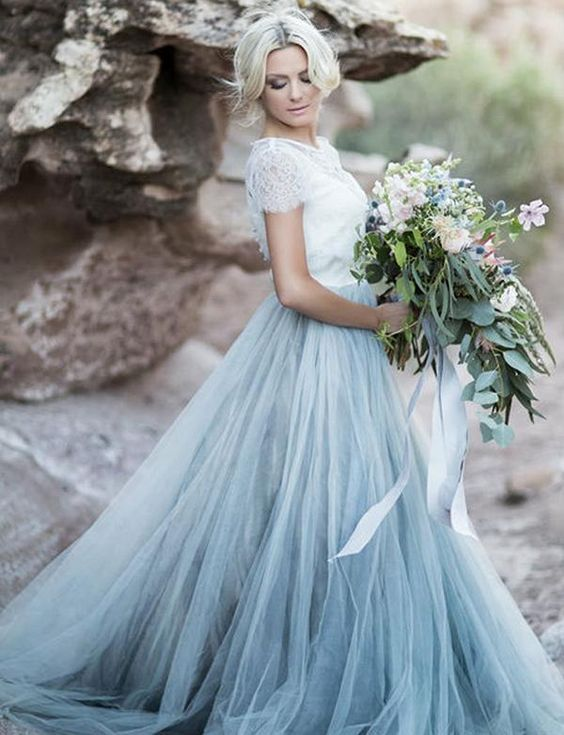 a beach wedding dress with a white lace bodice, a blue layered tulle skirt with a train looks spectacular