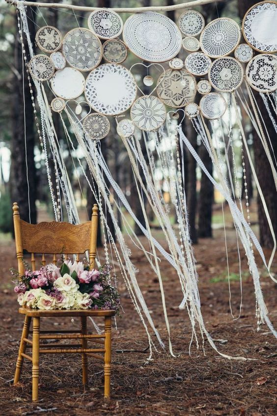 a boho woodland wedding arch done with embroidery hoops and long fringe is a lovely idea to rock, add blooms and voila