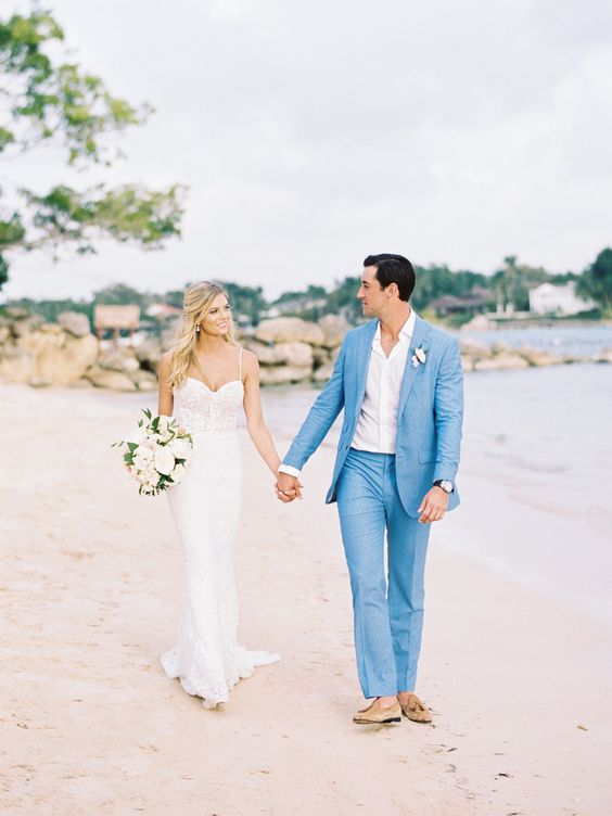 a bright blue groom's suit, tan moccasins and a white shirt for a bold and statement beach wedding look