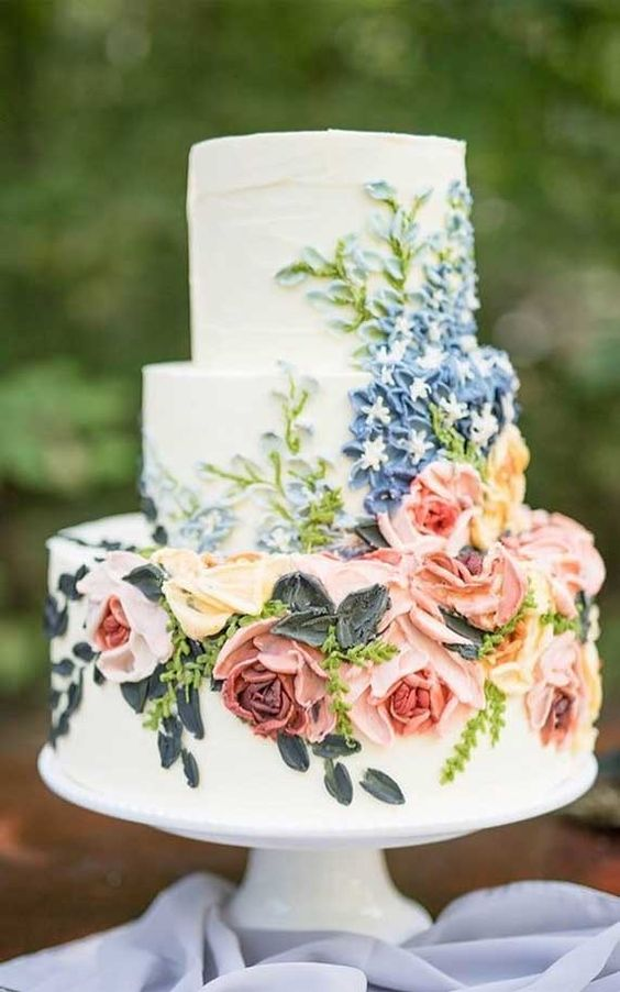 a bright floral textural wedding cake is a bold and fun idea for a spring or summer wedding