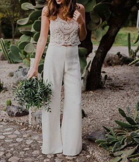 a chic bridal shower outfit with a lace embellished crop top and plain high waisted pants for a modenr bride-to-be