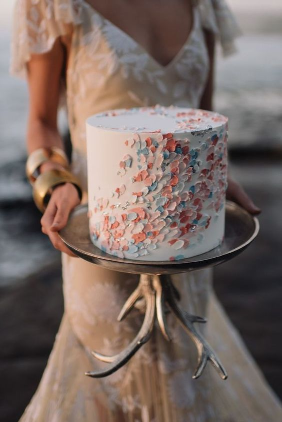 a chic textural pastel wedding cake with scallops and beads is a beautiful idea for a modern wedding