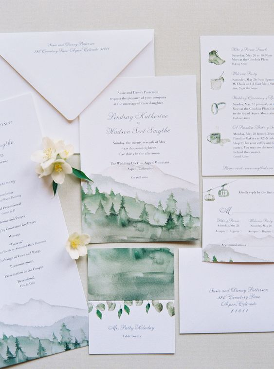 a cool wedding invitation suite in greens with all the mountain stuff handpainted is a great idea