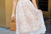 a crochet midi dress with spaghetti straps, nude shoes and a wooden bag are perfect for a summer bride-to-be