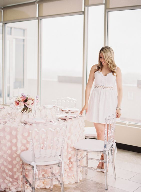 a cute mini dress on spaghetti straps with lace inserts is a classic idea for a bride-to-be