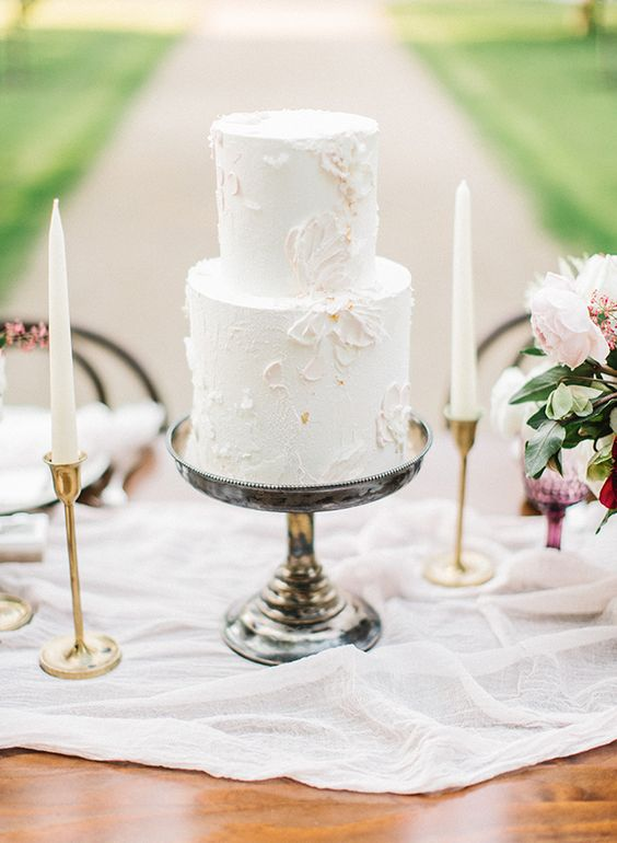 a delicate neutral textural wedding cake with floral patterns is a very refined and chic idea to go for