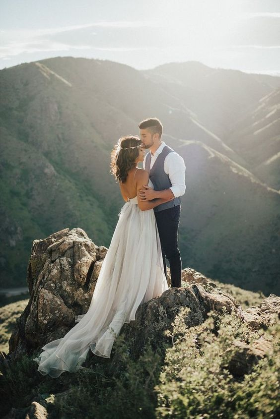 a gorgeous wedding portrait on top of the mountain is a fantastic idea for any couple
