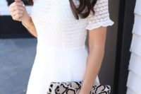 a lace mini dress with a turtleneck and a plain skirt plus an animal print clutch is a cute modern option to go