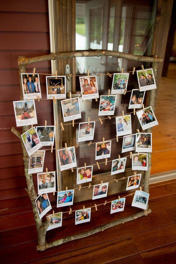 a rustic family tree with twine and lots of fmaily Polaroids put on clothespins is a simple and cute idea