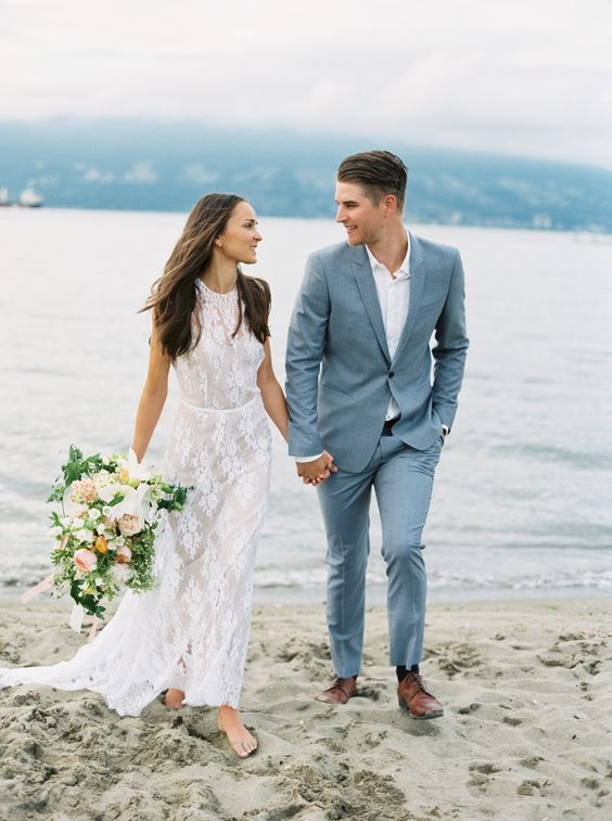 a simple and stylish light blue suit, a white shirt and brown shoes for a chic blue beach wedding