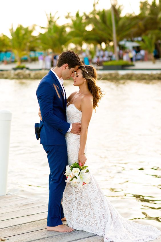 a super bold blue groom's suit with a white shirt for a tropical beach wedding