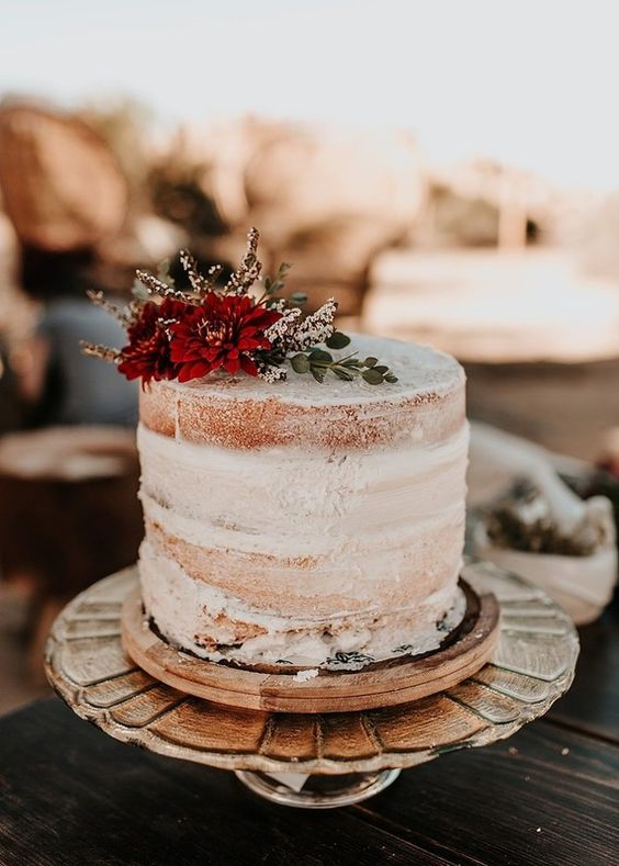 a textural naked wedding cake with fresh blooms on top is a yummy and chic idea for a wedding