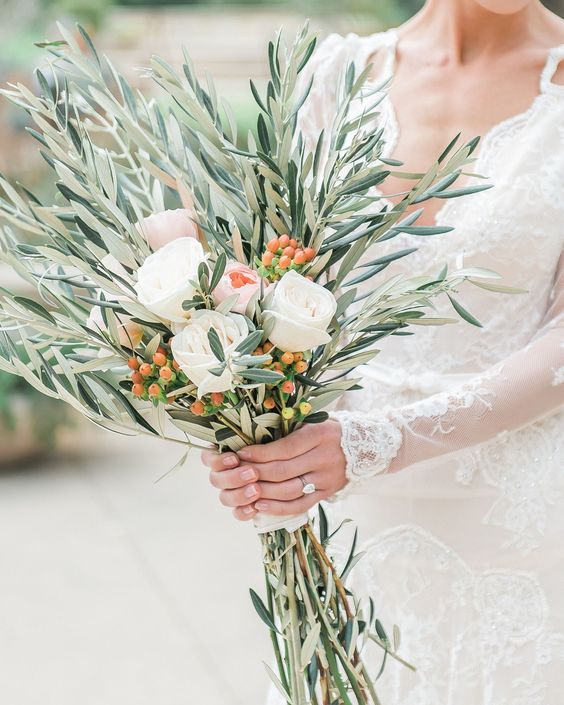 a wedding bouquet of olive branches, white blooms, berries is a bold and creative idea for a modern bride