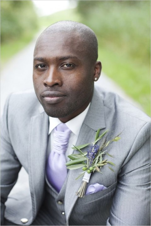 a wedding boutonniere with lavender, olive greenery and olives is a cool refreshing idea to go for