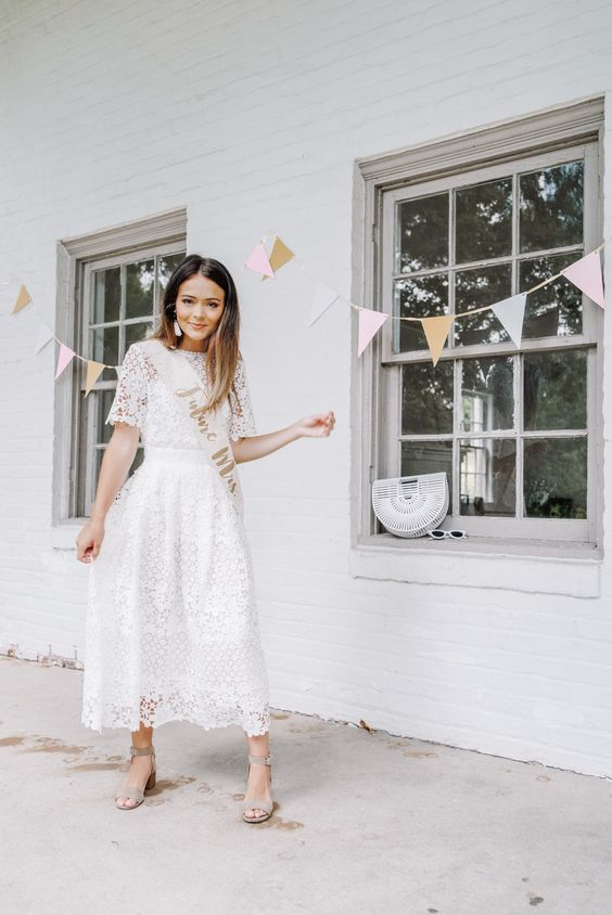 a white lace midi dress, statement earrings and grey shoes for a cute and chic summer bridal shower look