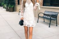 a white lace mini dress with an illusion neckline, long sleeves and anude shoes plus a black bag
