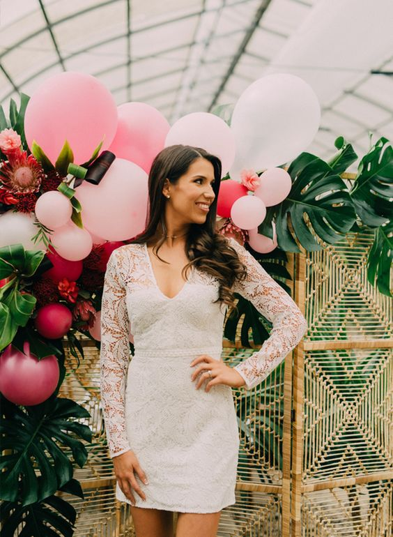 a white lace mini dress with long sleeves and a V neckline is timeless classics for a bridal shower