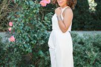 a white plain duo – a sleeveless crop top, a maxi skirt with slits and a pink lip for a minimalist look
