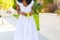 a white plain high low midi dress with a ruffle top, gold shoes and a neon yellow mini bag