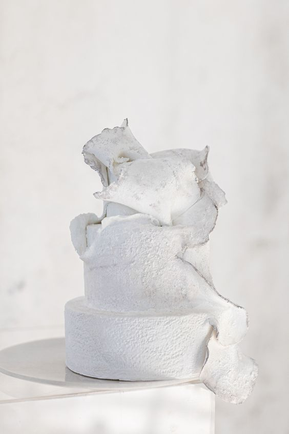 a white textural wedding cake with a melting effect is a very statement idea that wows