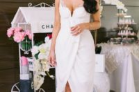 an elegant white lace wrap midi dress with an asymmetrical skirt, white heels and chic accessories