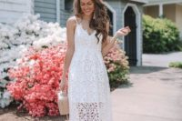 awhite lace midi dress with spaghetti straps and an illusion skirt, a blush bag and blush shoes for a romantic girl