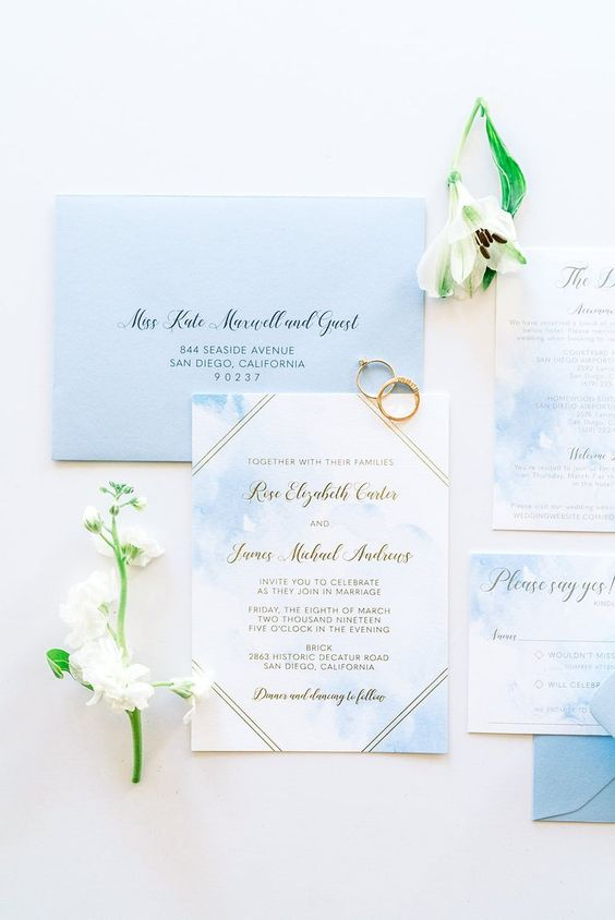 beautiful light blue and white wedding stationery with gold touches is a chic idea for a beach wedding