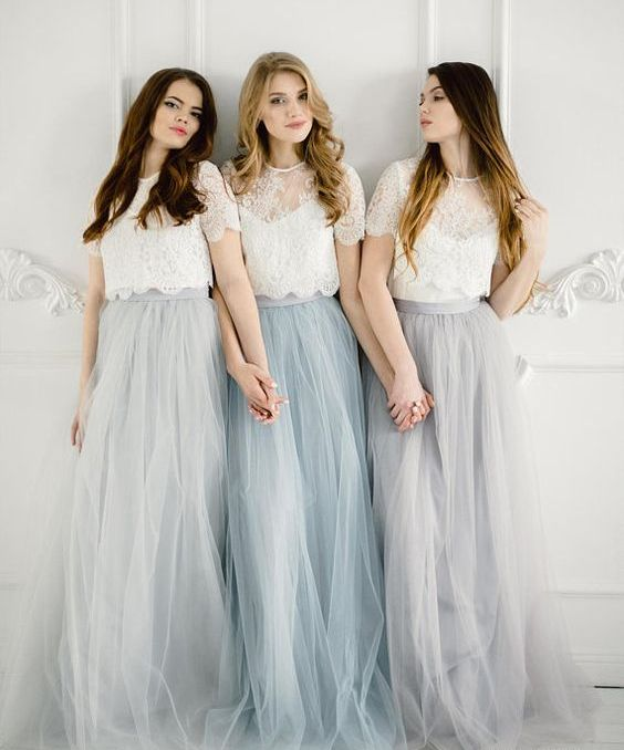 chic bridesmaid looks with white lace crop tops with illusion necklines and grey and blue tulle maxi skirts