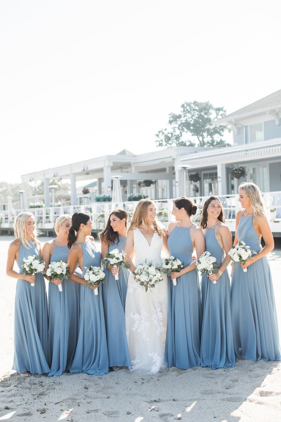 elegant blue halter neckline maxi bridesmaid dresses are amazing for a blue beach wedding
