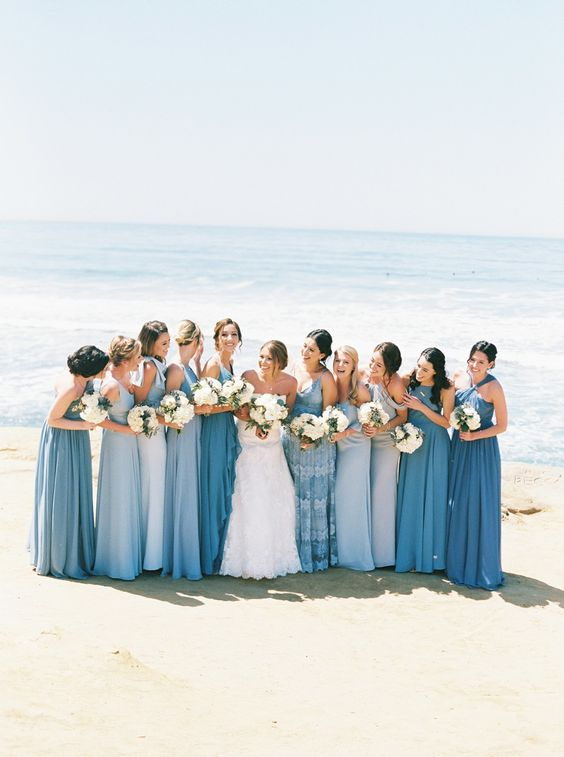 mismatching blue bridesmaid dresses with various designs and looks are nice for a blue beach wedding