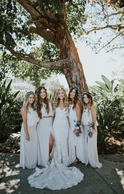 neutral summer bridesmaid looks with spaghetti strap crop tops and white skirts with slits