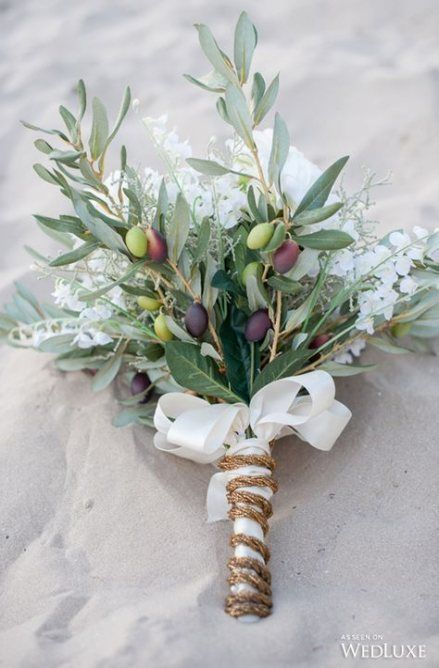 olive branches with green and black olives, white blooms, a ribbon bow and some twine to wrap up the bouquet