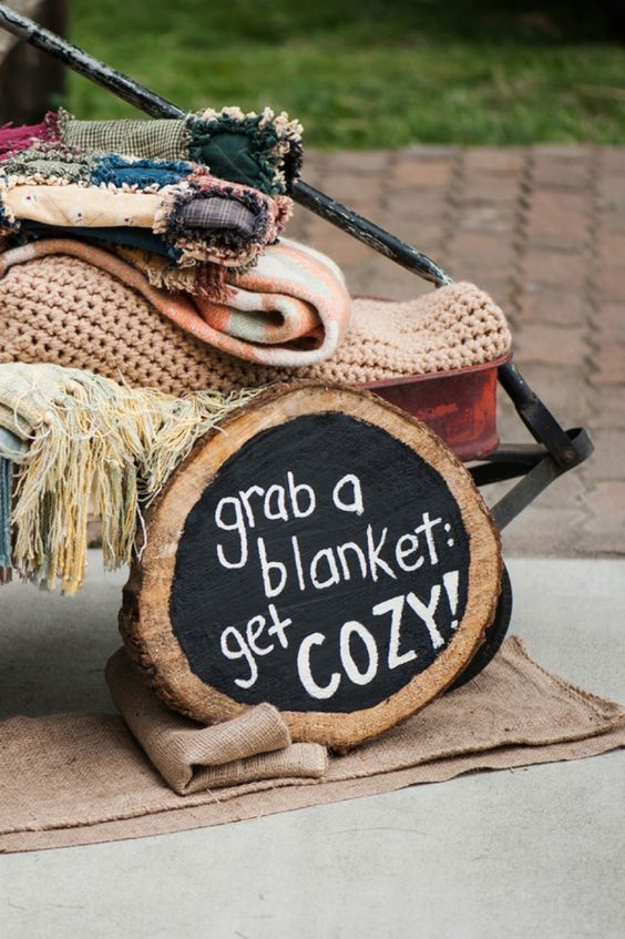 provide your guests with blankets and add a cool sign to mark the storage space