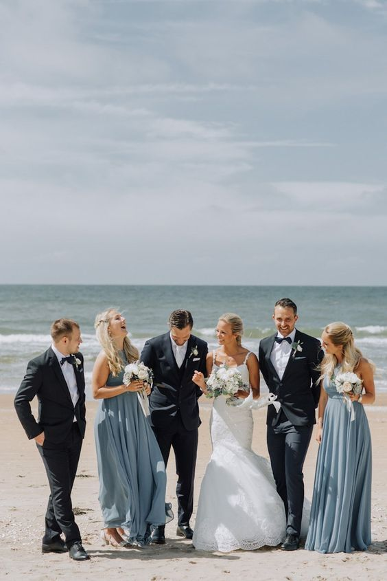 stylish and airy light blue maxi bridesmaid dresses for a blue beach wedding