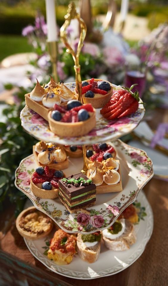 a beautiful wedding dessert stand of gorgeous mismatching vintage floral plates is a lovely idea for a refined wedding with a vintage feel