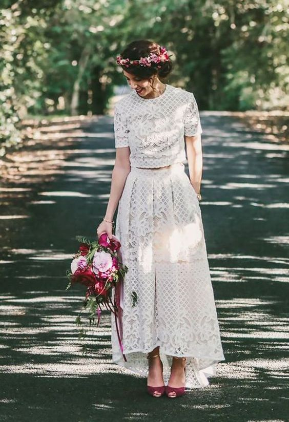 a boho lace wedding separate with a crop top with a high neckline and short sleeves, a high low skirt plus purple shoes