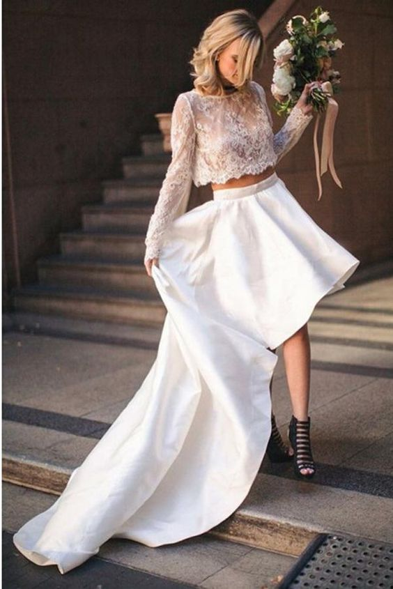 a bold modern wedding separate with a lace crop top with long sleeves and a high neckline, a plain high low skirt with a train and black shoes