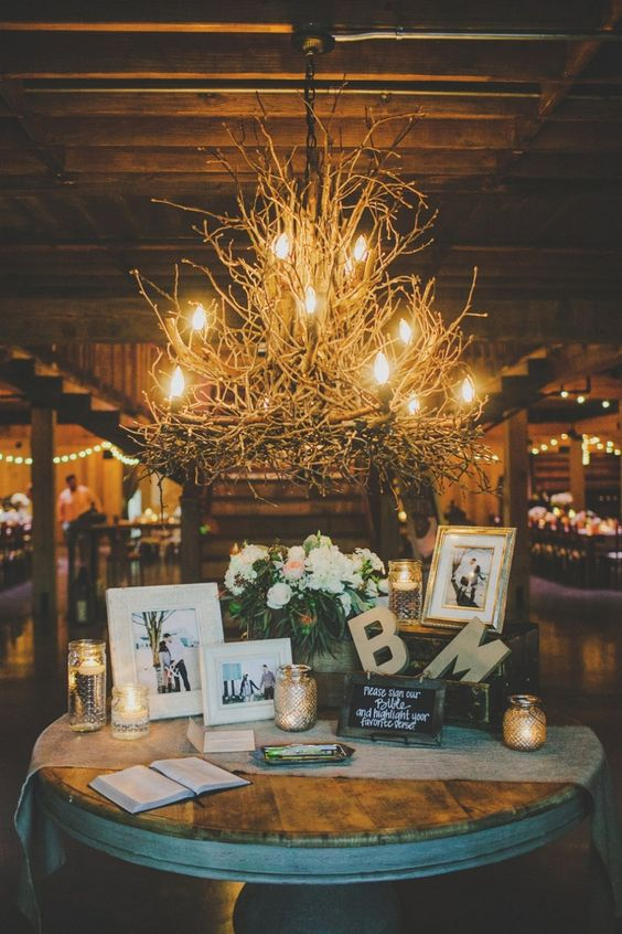 a branch chandelier, blooms, candles, framed photos and monograms