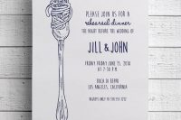 a cool and simple navy and white rehearsal dinner invitation with pasta on a fork hints on the main dish at the dinner