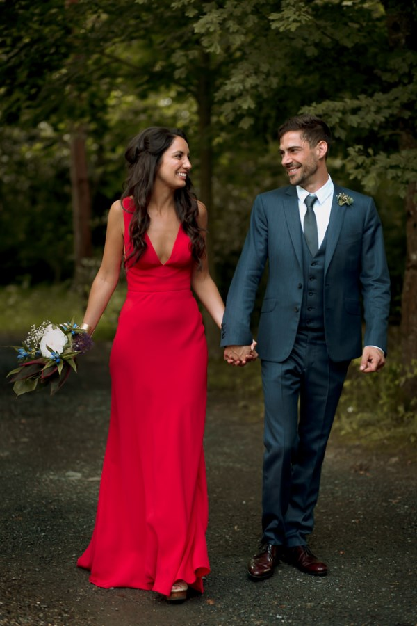 a fiery red A-line wedding dress with thick straps and a plunging neckline is a non-traditional solution