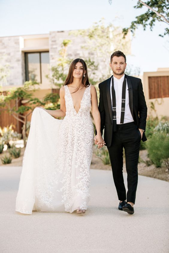 a lace thick strap wedding A-line wedding dress with a covered plunging neckline is a romantic idea