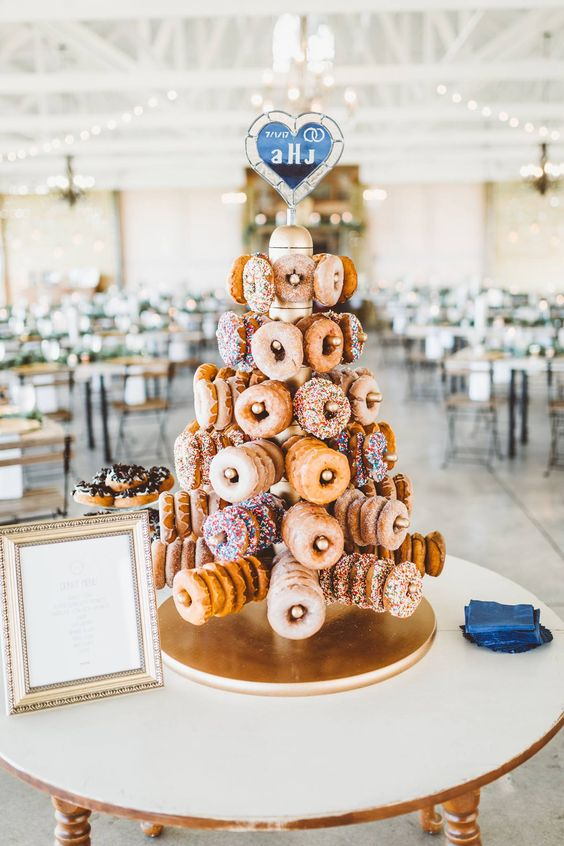a lovely modern wedding dessert stand - a tower with holders for donuts is a fun and gorgeous idea to rock