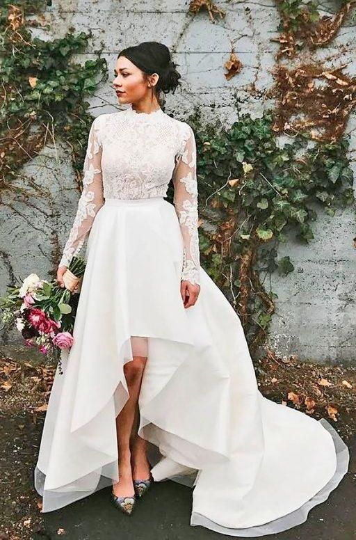 a modern bridal separate with a lace top with a turtle neckline and long sleeves, a textural high low skirt with a train and printed shoes