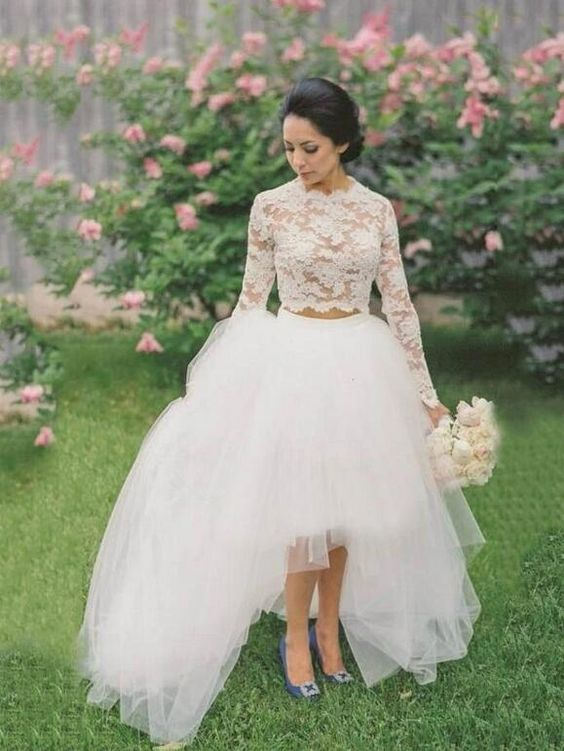 a pretty wedding separate with a lace crop top with long sleeves and a tulle layered high low skirt with a trian and blue Carrie Bradshow shoes