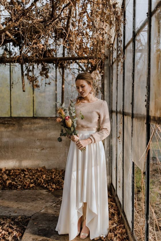 a romantic and casual bridal look with a tan sweater, a neutral pleated high low skirt and silver shoes for a wow look